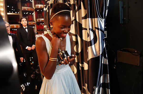 """Lupita Nyong'o with her Oscar after winning Best Actress for """"12 Years a Slave"""" at the 86th Annual Academy Awards. (Al Seib / Los Angeles Times)"""
