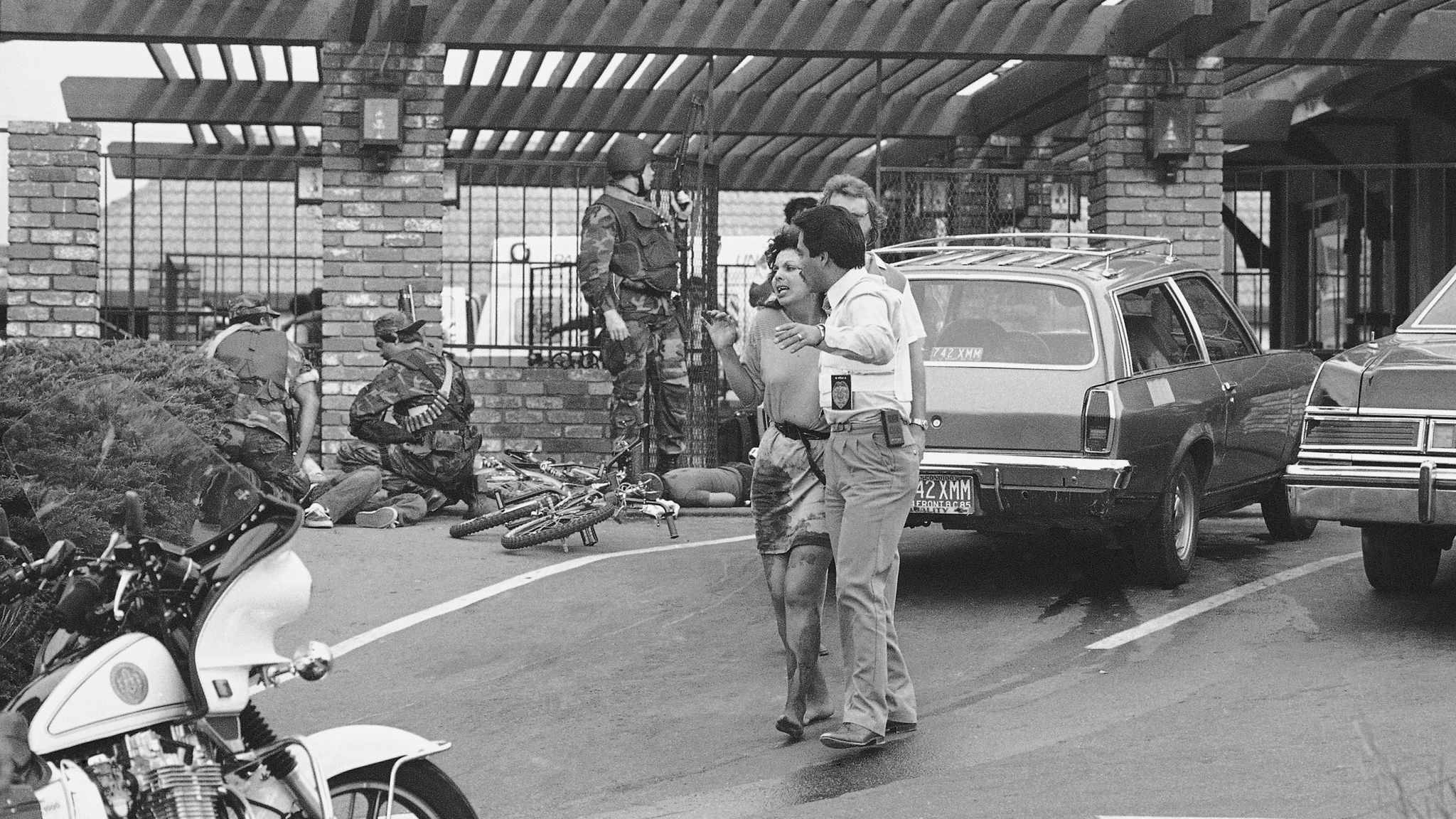 A wounded victim is led away from the scene of a mass shooting at a McDonald's in San Ysidro, Calif., in 1984.