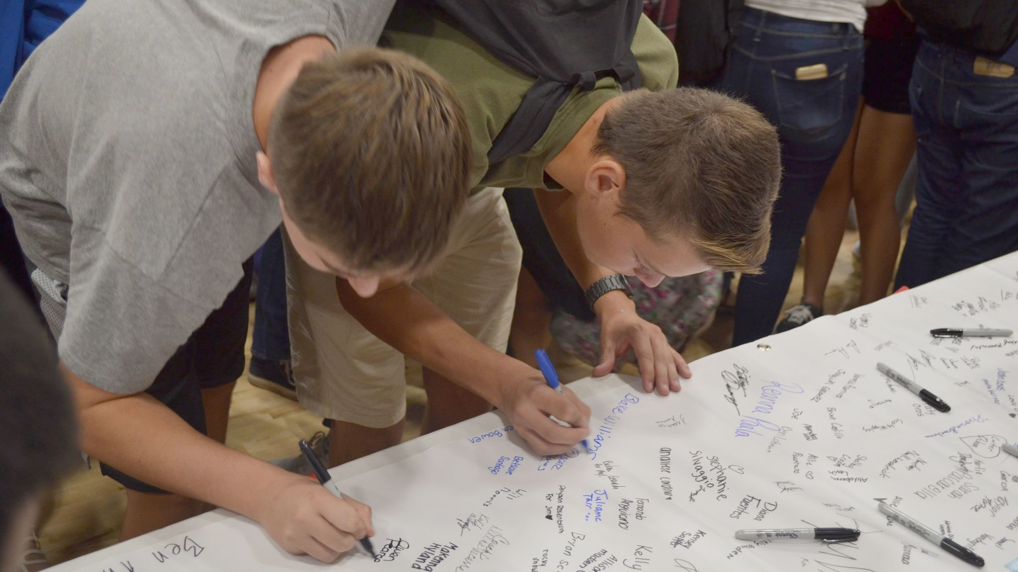 Two Ramona High students add their names to the hundreds of others accepting  Rachel's Challenge.