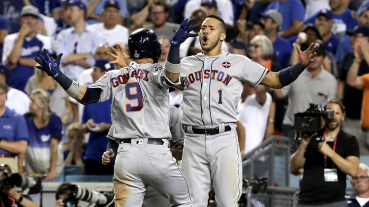 Astros shortstop Carlos Correa greets teammate Marwin Gonzalez after he hit a solo home run off Kenley Jansen. (Robert Gauthier / Los Angeles Times)