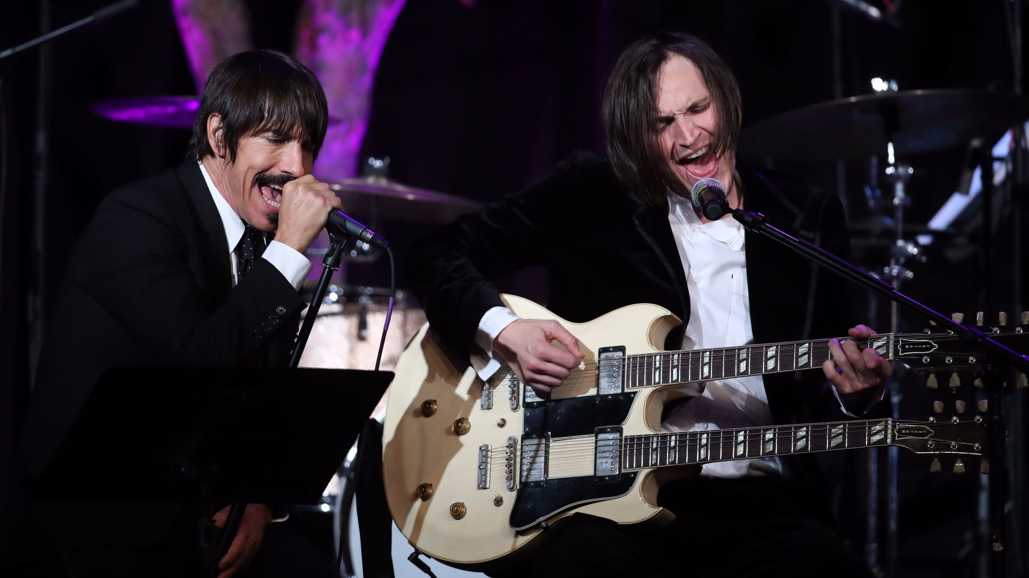 Anthony Kiedis and Josh Klinghoffer of the Red Hot Chili Peppers performs onstage at the Whole Child International's inaugural gala in Beverly Hills.