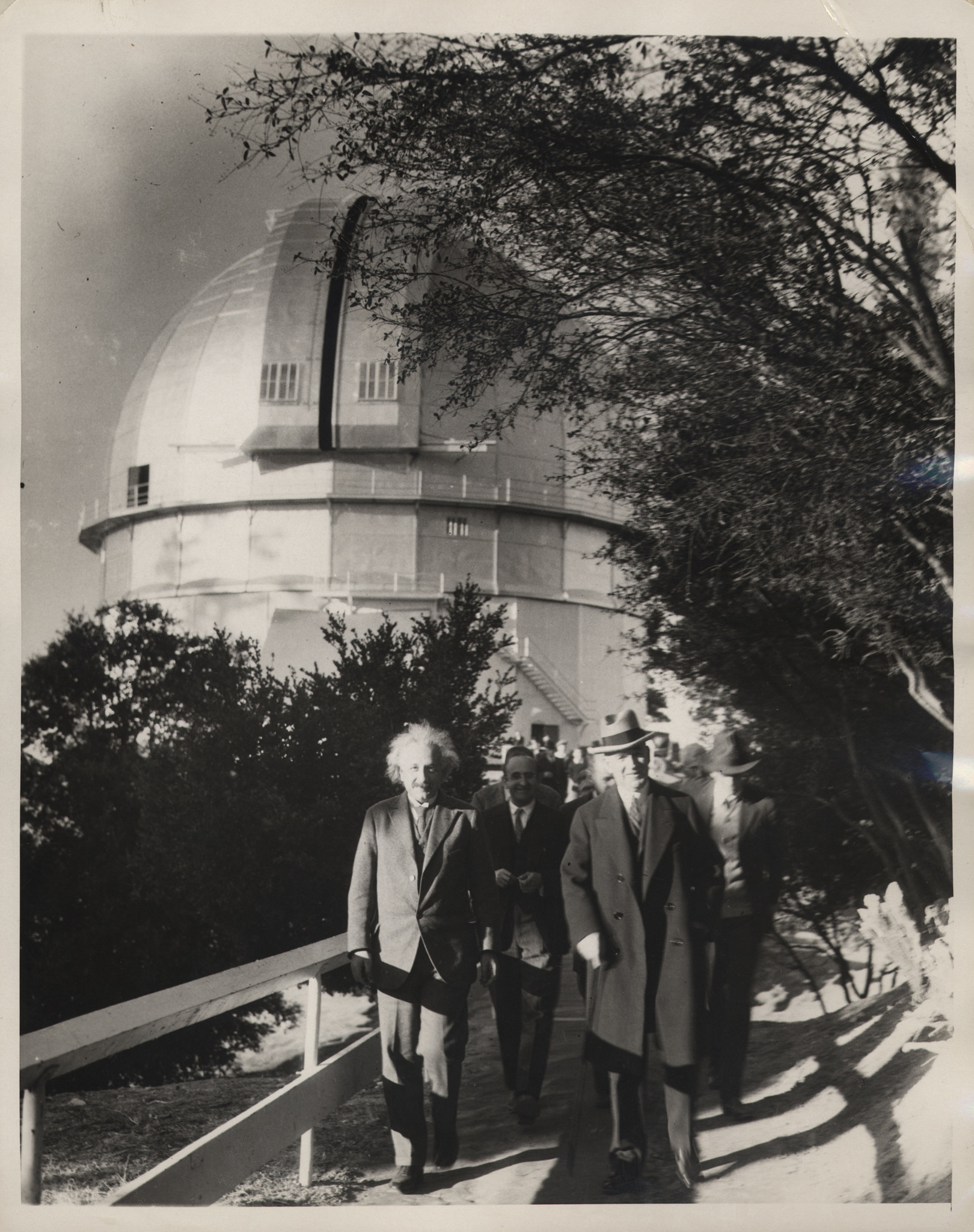 Albert Einstein, Walther Mayer and William W. Campbell at the  telescope dome in 1931.