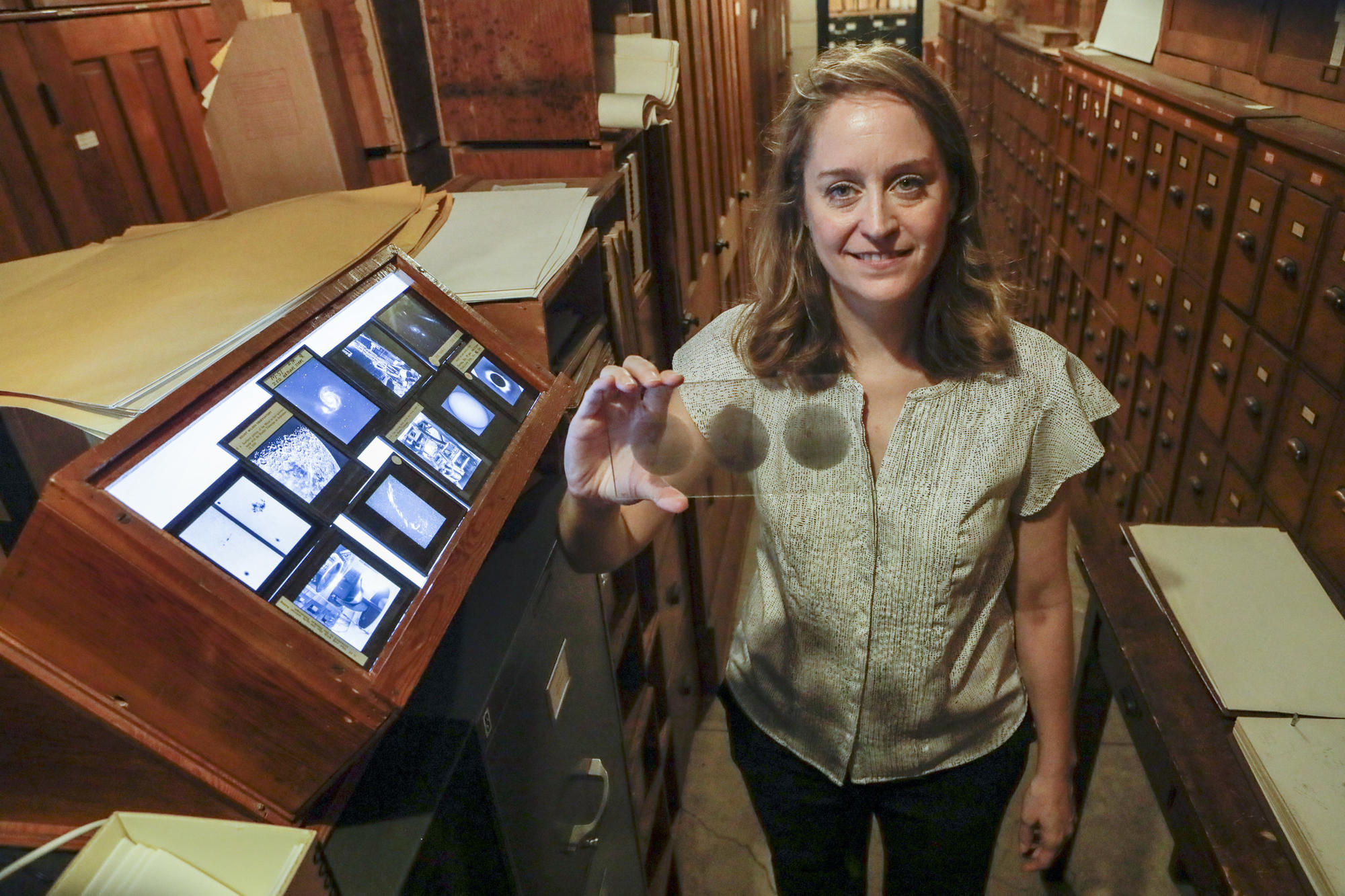 Cynthia Hunt, chair of the History Committee for the Carnegie Observatories, in the vault that holds 100 years' of worth photographic glass plates of stars, the sun, the moon and galaxies taken with the 60-inch and 100-inch telescopes at Mt. Wilson Observatory.
