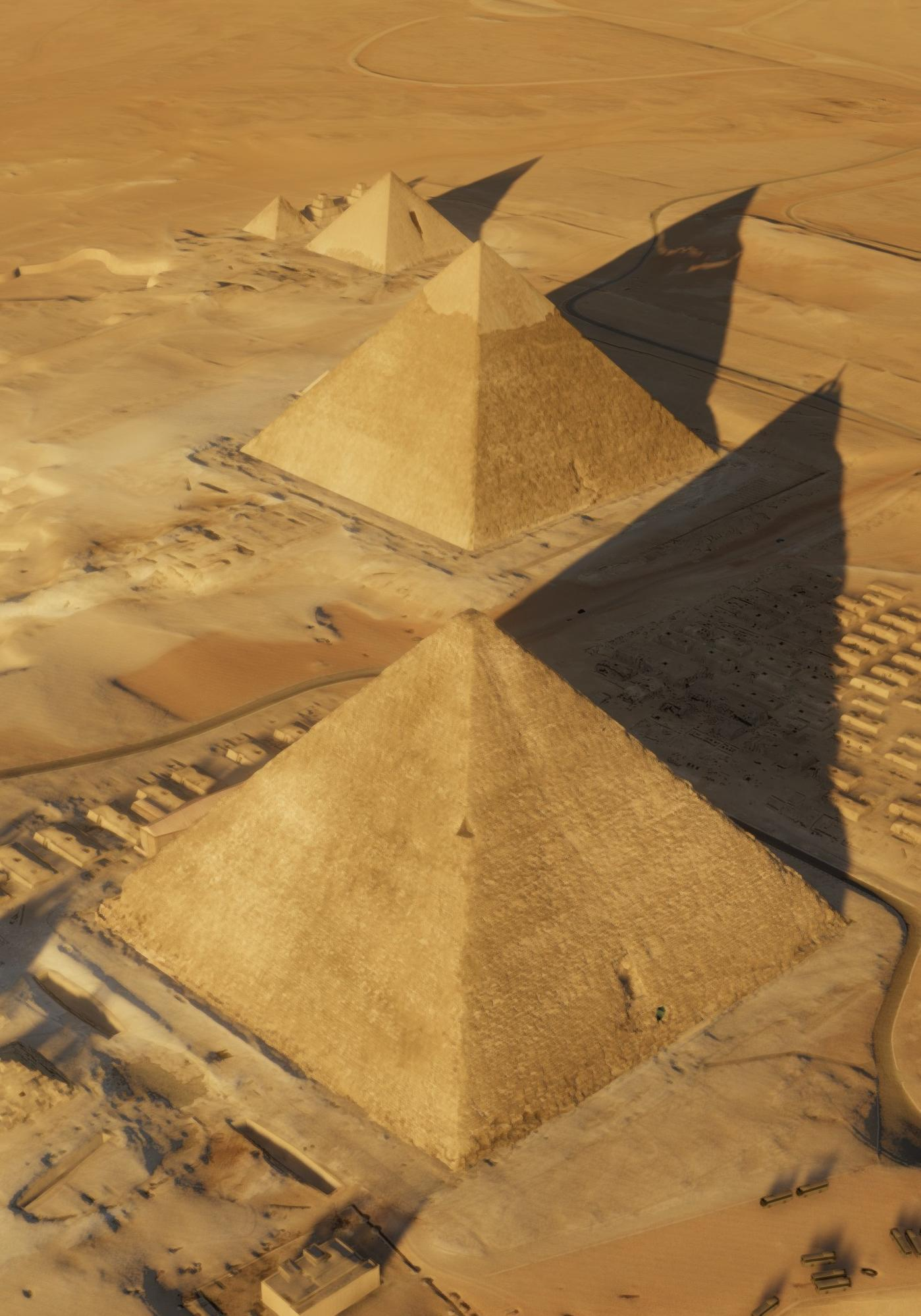 An aerial view of the pyramids at Giza. Khufu's Pyramid is in the foreground.