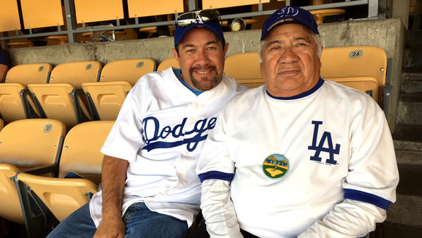 Anthony Diaz surprised his father, Afle, with Game 7 tickets on Tuesday night after the Dodgers won Game 6. (Hailey Branson-Potts / Los Angeles Times)