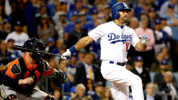 Andre Ethier follows through on a run-scoring single during the sixth inning of Game 7. (Ezra Shaw / Getty Images)