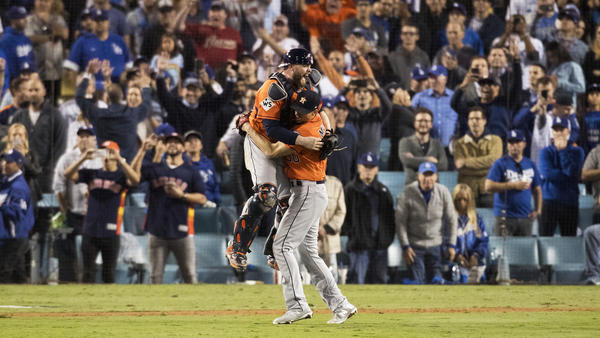 Astros players begin to celebrate after recording the final out in Game 7. (Gina Ferazzi / Los Angeles Times)