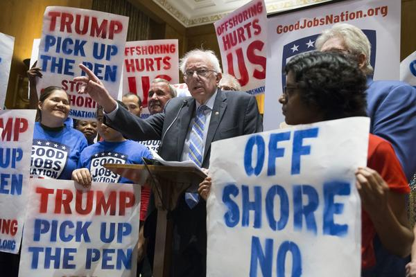 Vermont Sen. Bernie Sanders speaks among supporters at an event calling on President Trump to uphold campaign promises on Capitol Hill in Washington on Sept. 19, 2017. (Michael Reynolds/EPA)