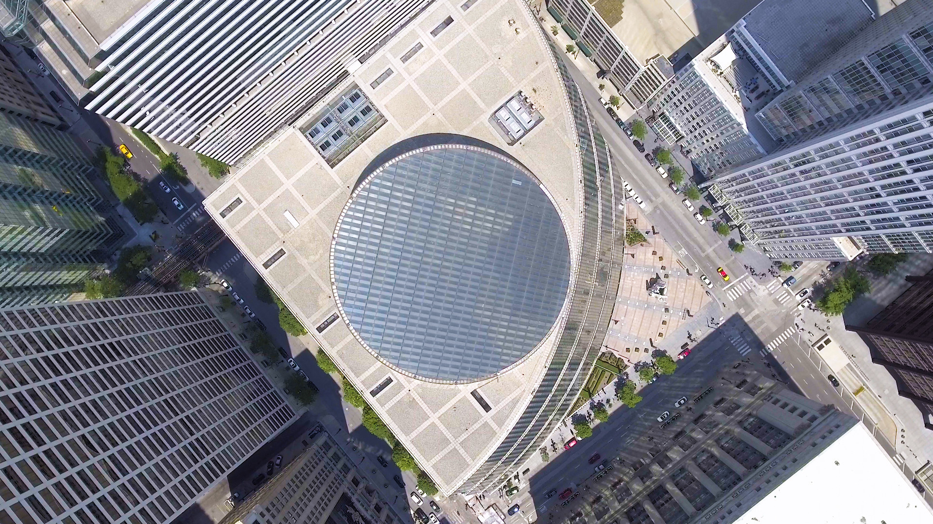 An aerial view, showing the building's curving front facade.