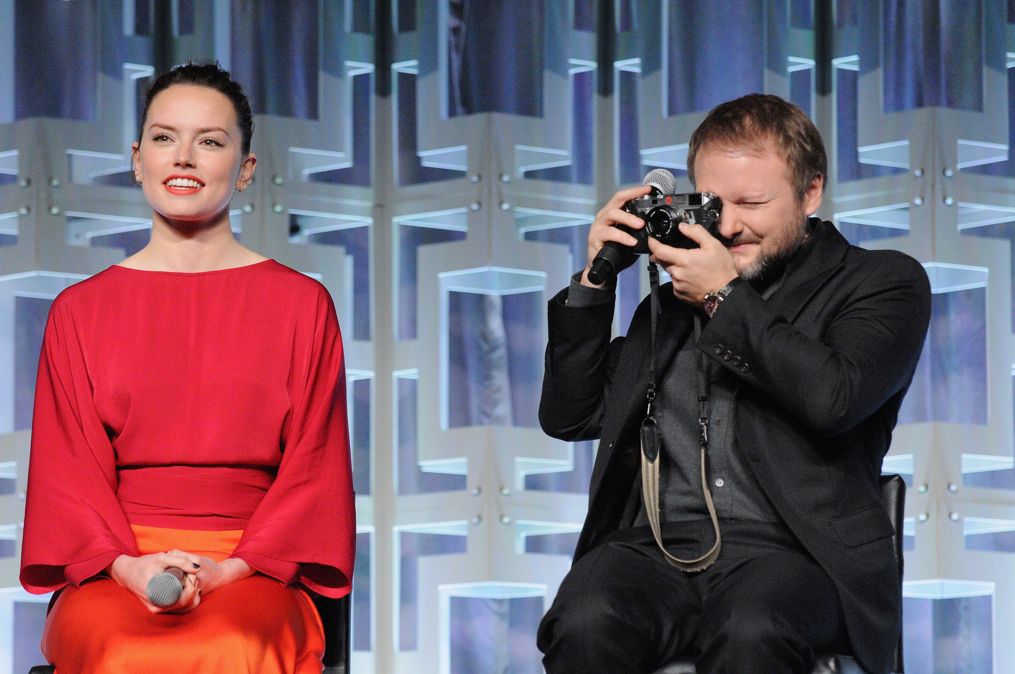"Daisy Ridley and Rian Johnson appear at the 2017 ""Star Wars"" Celebration. (Gerardo Mora/Getty Images for Disney)"
