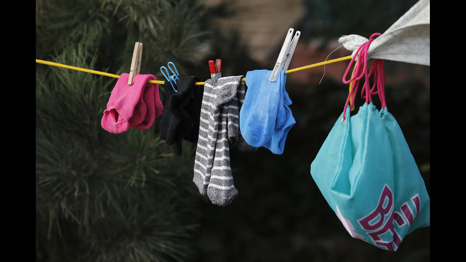 Socks are hung to dry outside Lisa Weber's camp along the Santa Ana River.