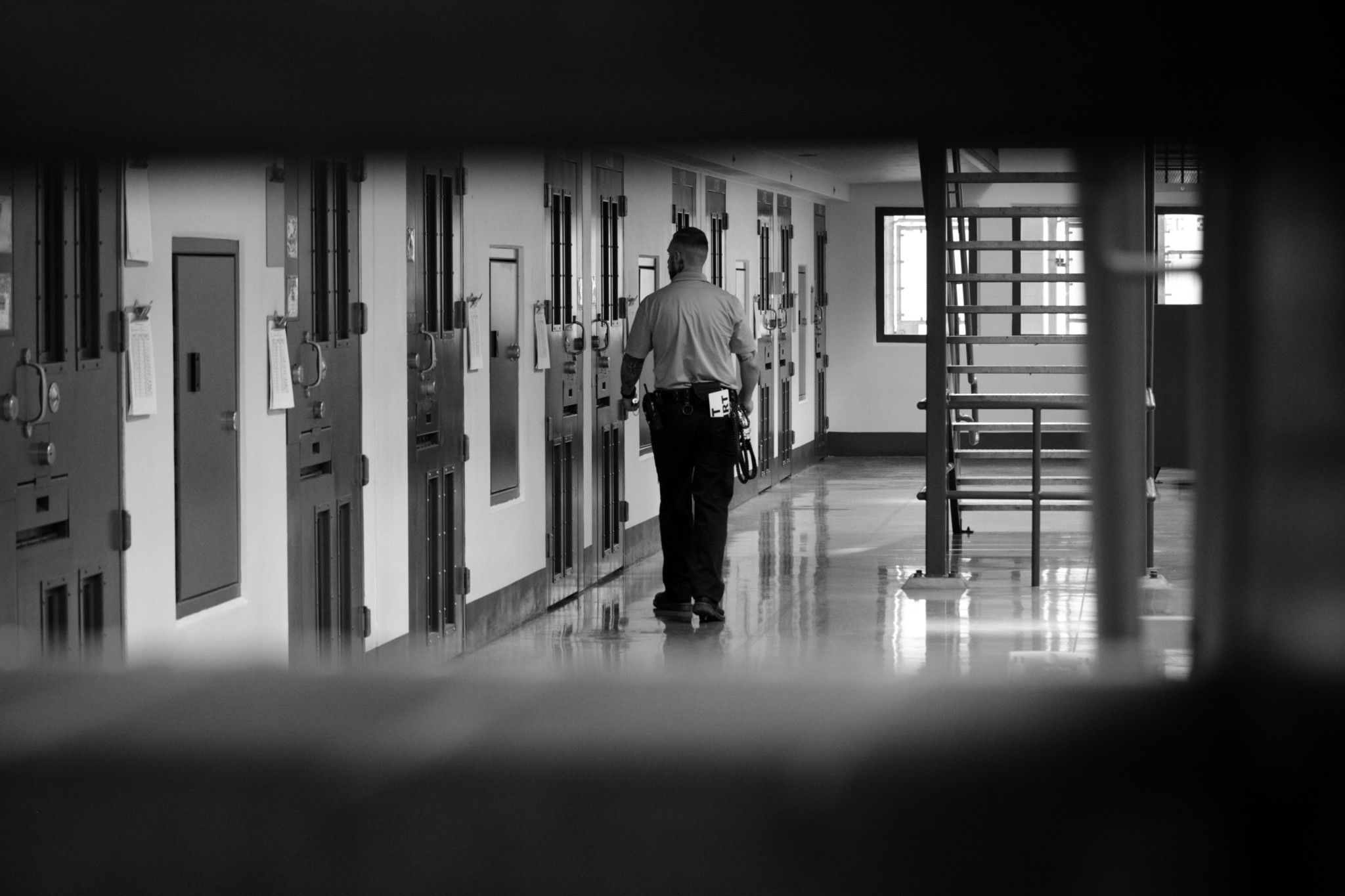 A guard on security rounds at Adelanto Detention Facility.