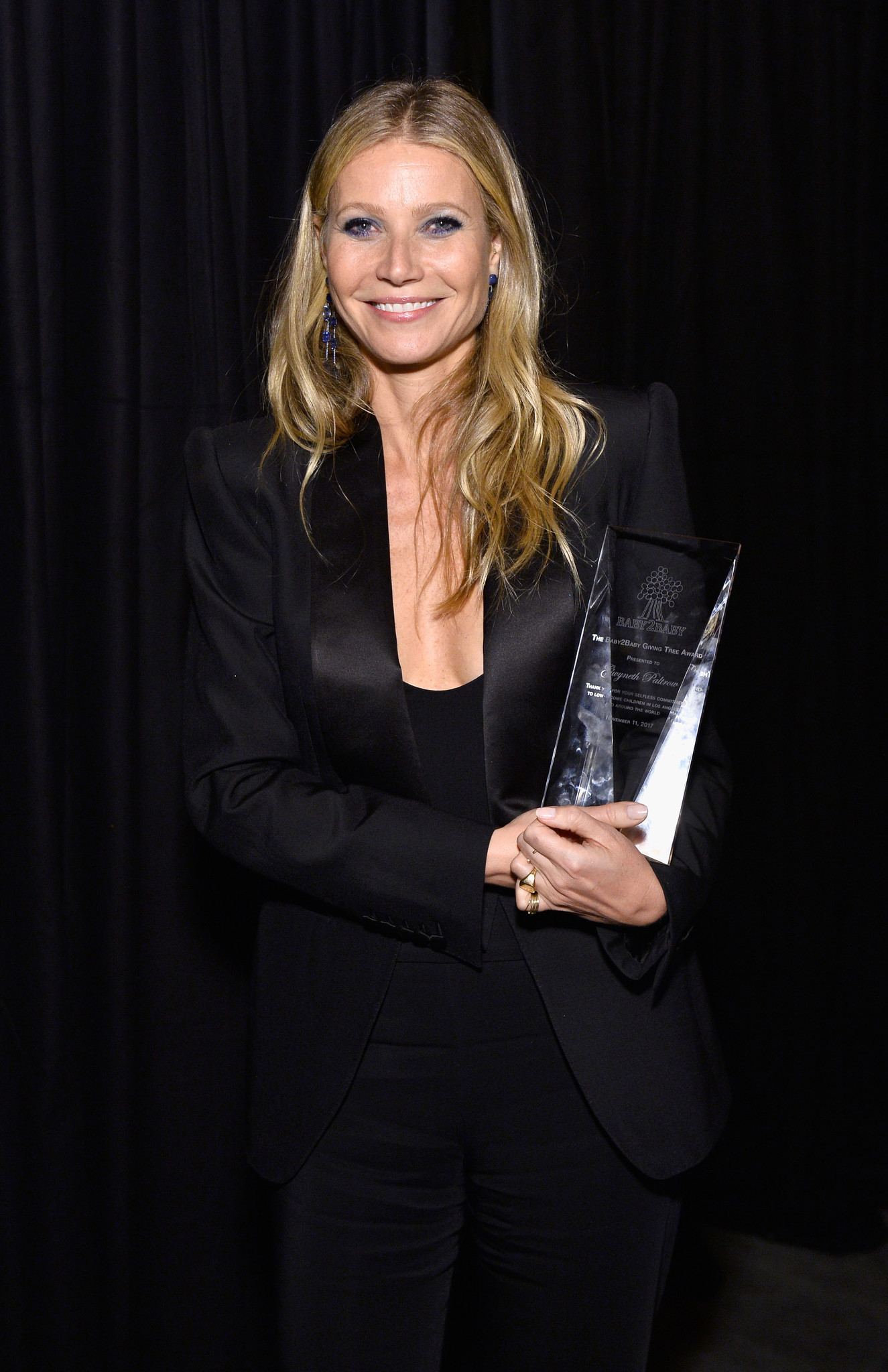 Gala honoree Gwyneth Paltrow holding the Giving Tree Award at the Baby2Baby Gala presented by Paul Mitchell.