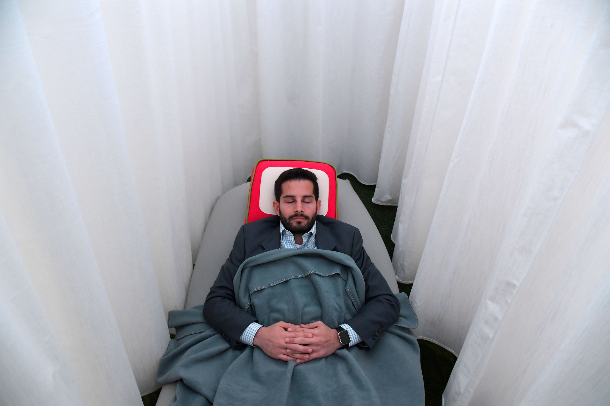 Napping on the job could possibly be a game changer for sleep-deprived nations