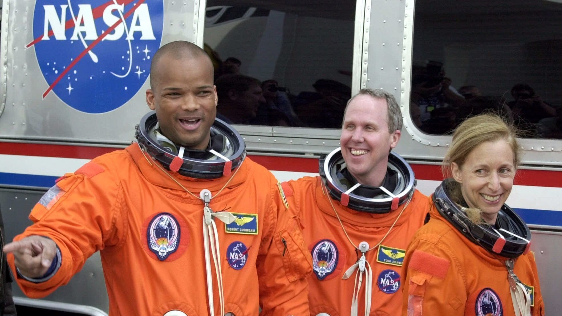Space shuttle Atlantis mission specialists Robert Curbeam, Thomas Jones and Marsha Ivins, from left, leave crew headquarters Wednesday, Feb. 7, 2001 at Cape Canaveral, Fla.