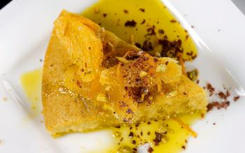 Orange and olive oil semolina cake with pistachios, chocolate and olio nuovo