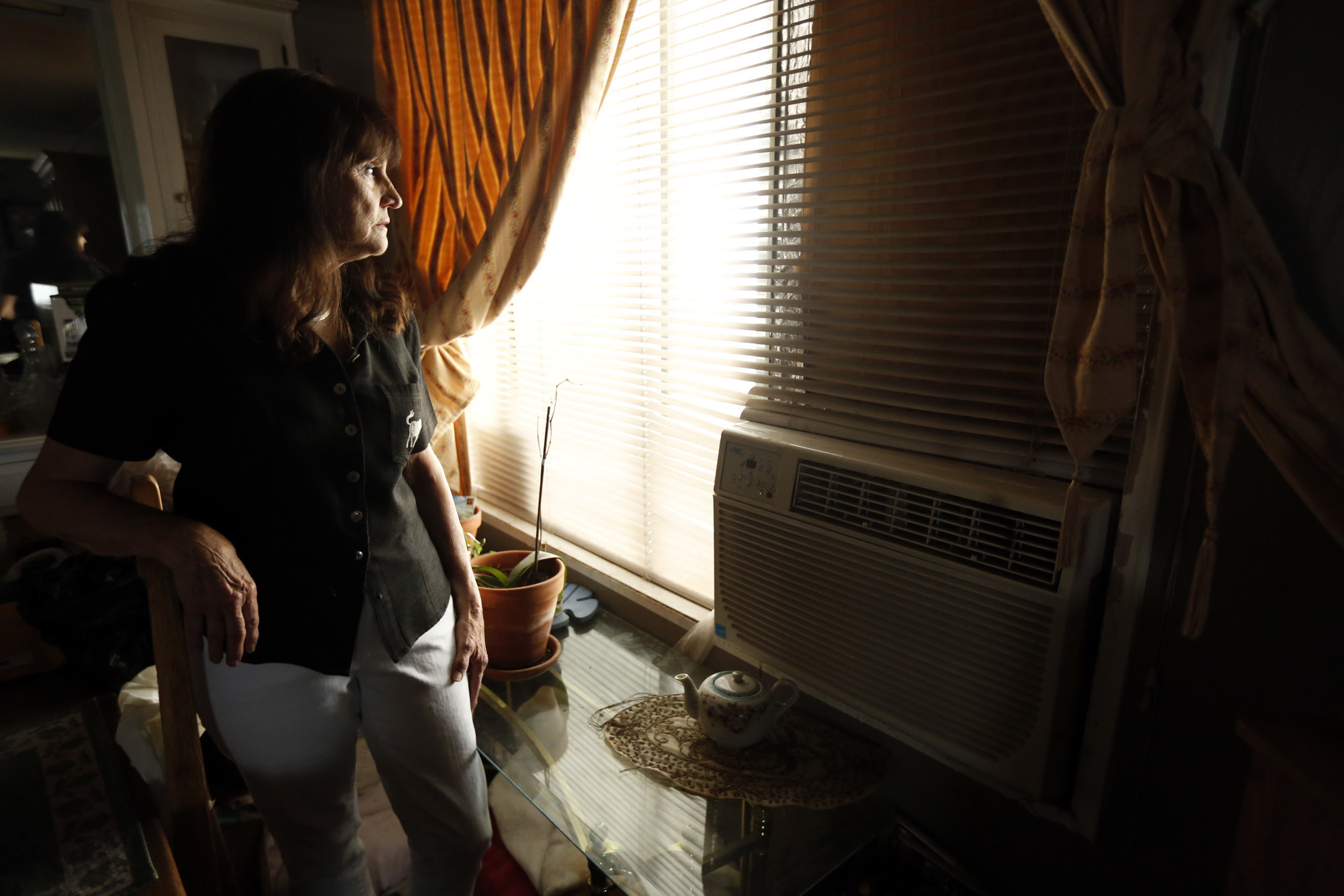 SUN VALLEY, CA — NOVEMBER 7, 2017 — Joan Winget, 75, stands next to her air conditioner that she l
