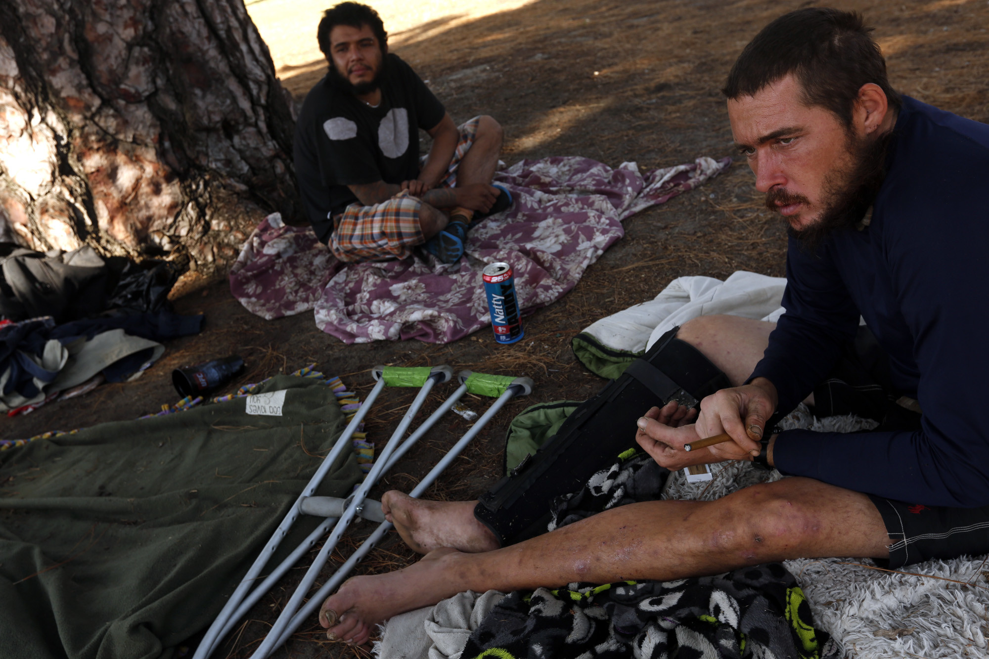 "Marine Corp veteran Jason McKenney, 34, from Salem, Mass., right, and Joseph Montoya, 27, of North Hills, are living homeless in North Hollywood Park in North Hollywood. ""I woul"