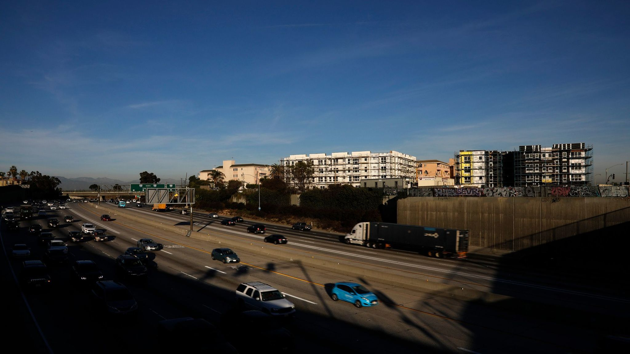 LOS ANGELES, CA - NOVEMBER 21, 2017 — Traffic flows below a pair of homeless housing developments t
