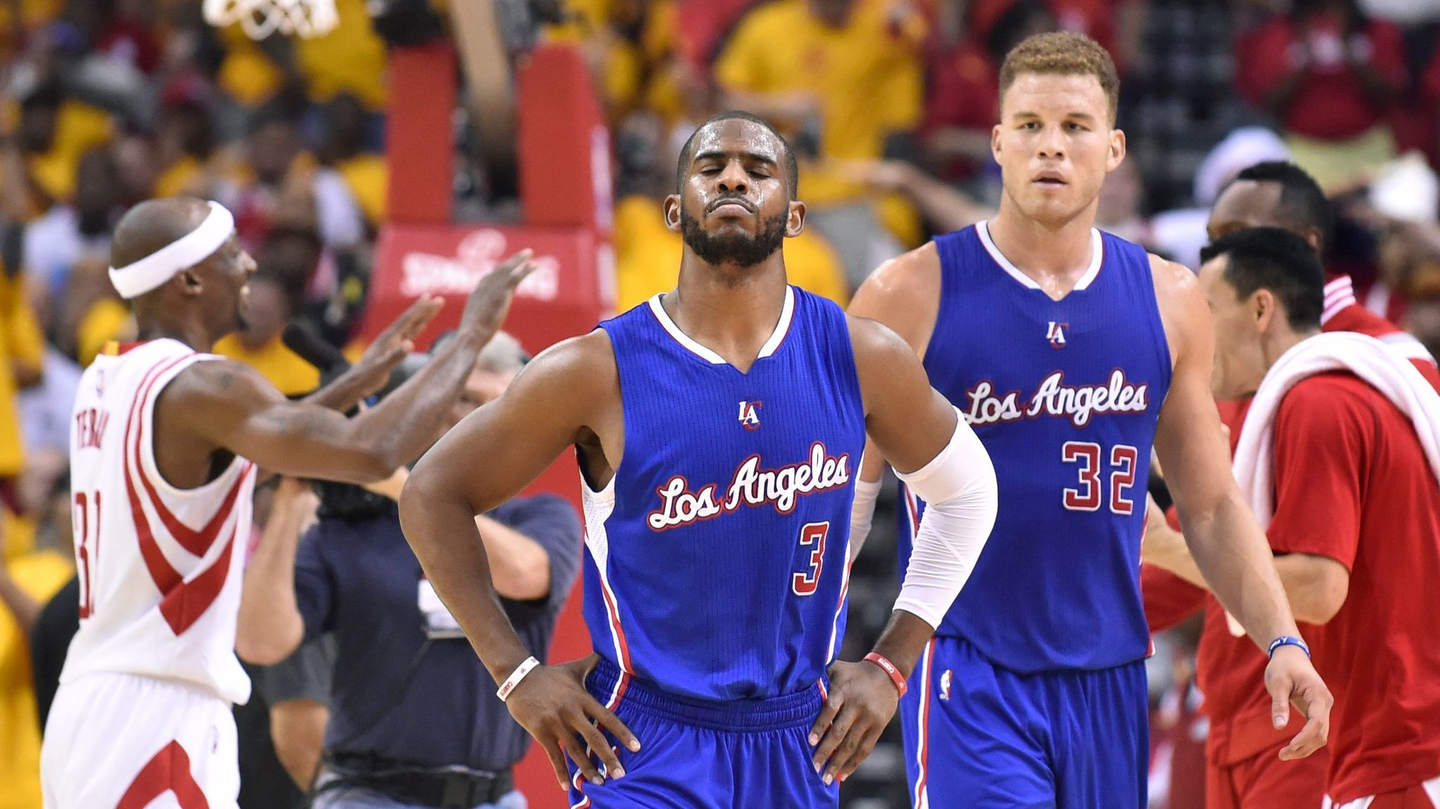 HOUSTON, TEXAS MAY 12, 2015-Clippers Chris Paul, left, and Blake Griffin walk off the court trialing