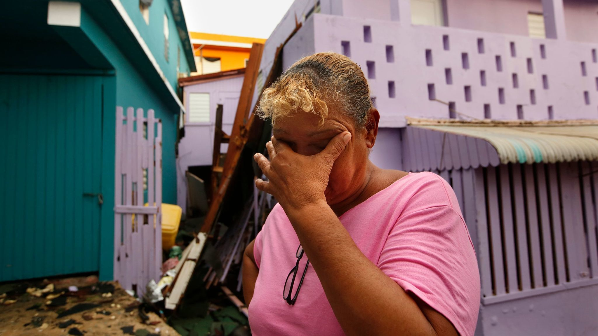 SAN JUAN, PUERTO RICO--SEPT. 21, 2017-- Sonia Viruet, 61, who lives in La Perla, Puerto Rico, takes