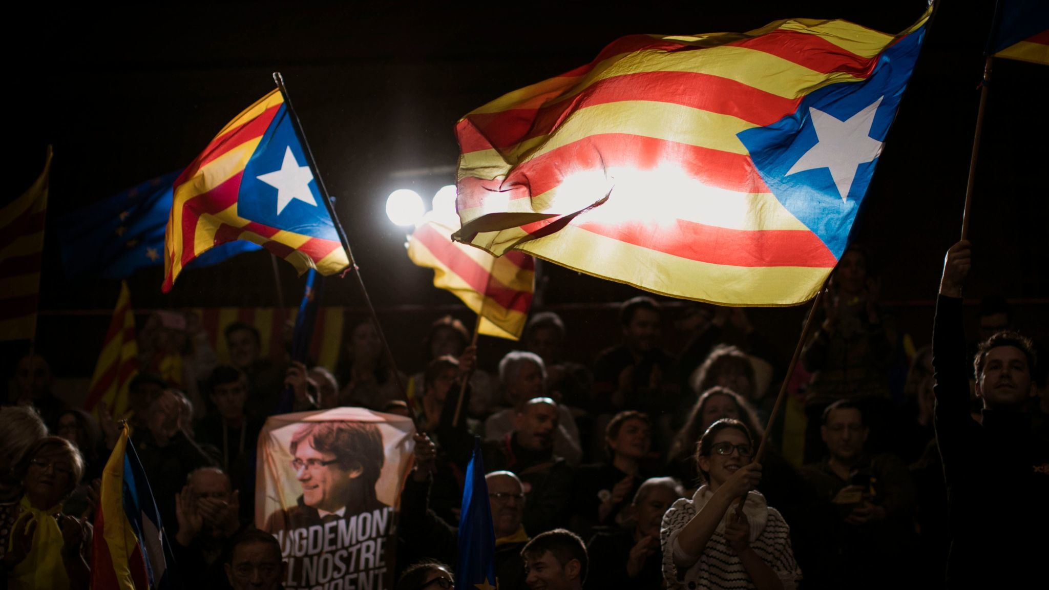 Supporters of ousted Catalan President Carles Puigdemont wave independence flags during the electora