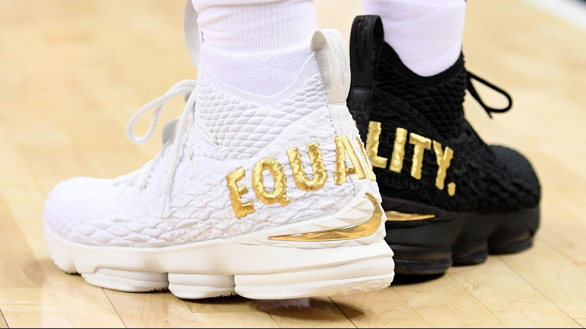 e4731b4a52dd LeBron James wears 1 black shoe
