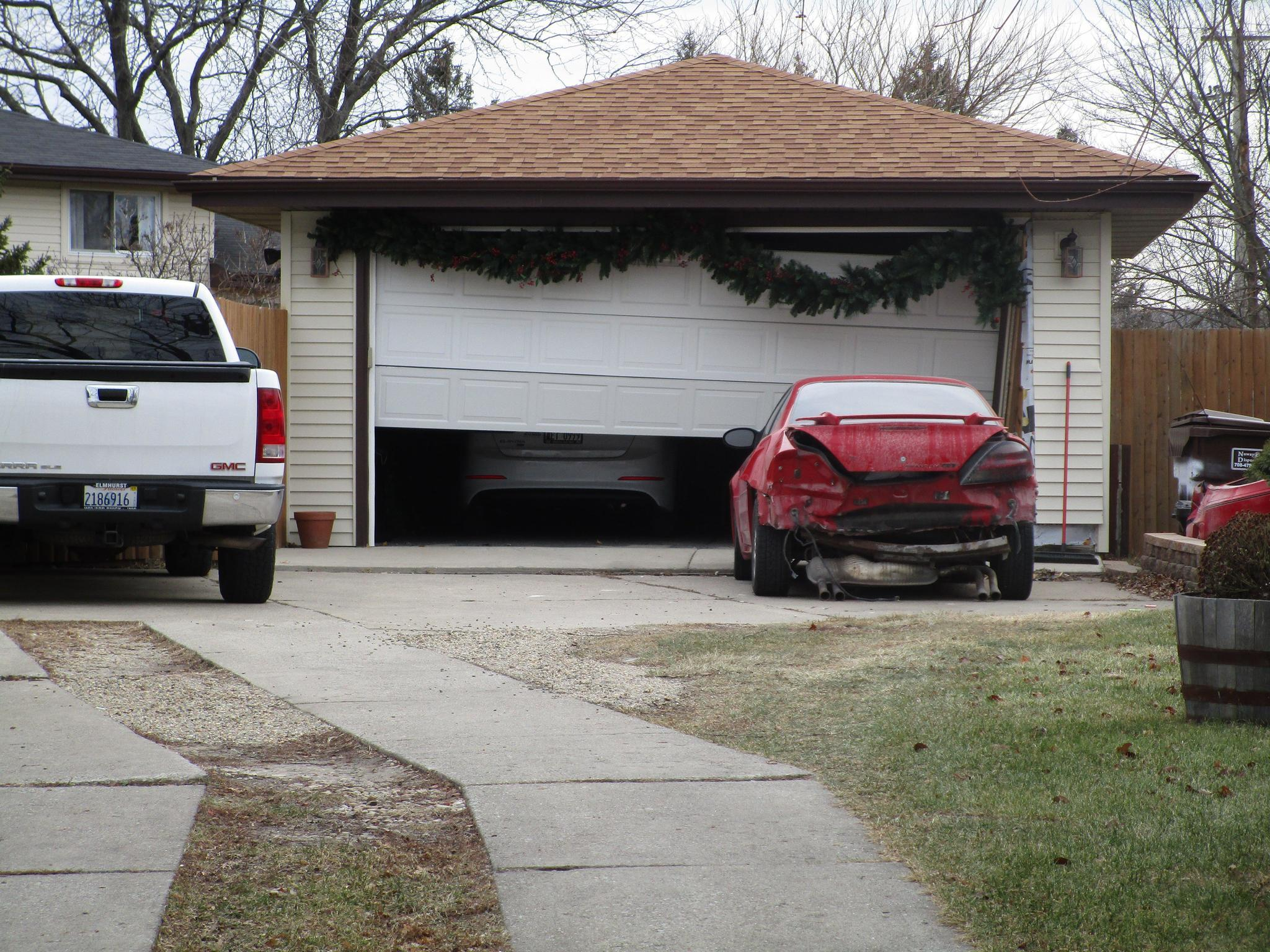 Four Arrested After Vehicle Damages Car Garage In Tinley