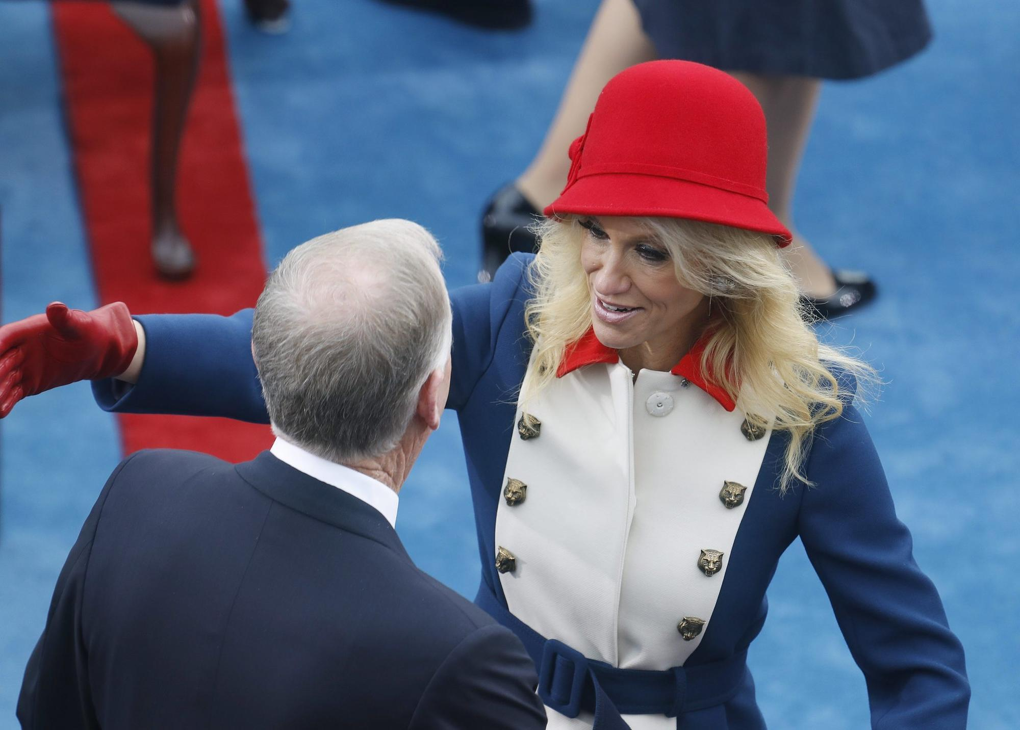 The cat head buttons on Kellyanne Conway's military coat
