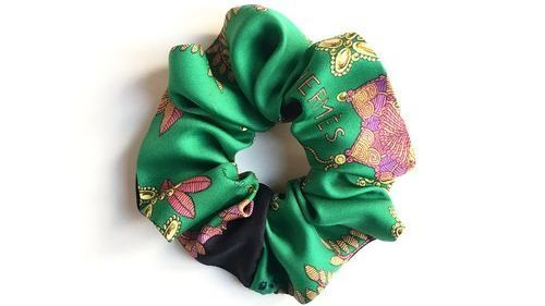 A scrunchie refashioned from a vintage Hermès scarf, designed by Comfort Objects.