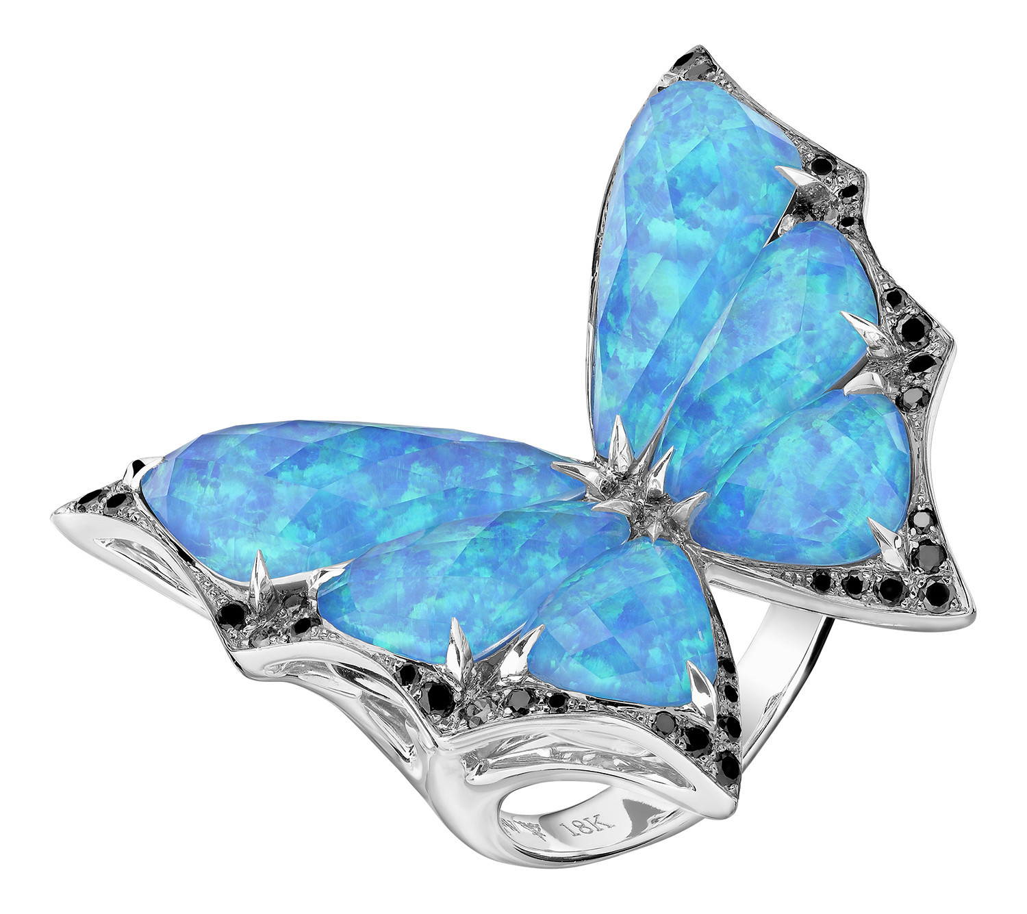 From Stephen Webster's nature-inspired Fly by Night collection is this butterfly ring made with black opalescent and clear quartz.