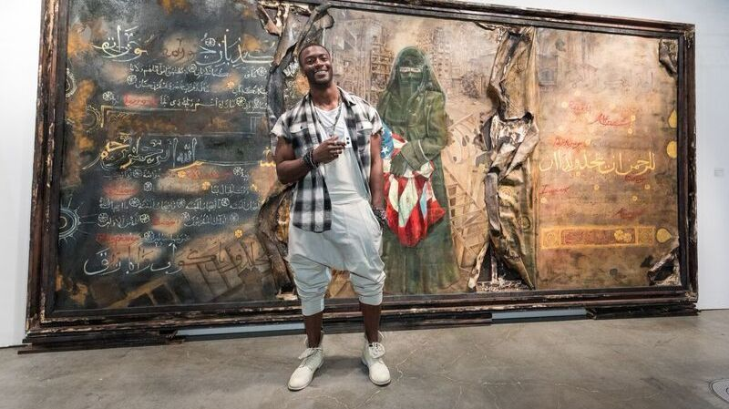 Aldis Hodge with his painting at the LA Art Show.