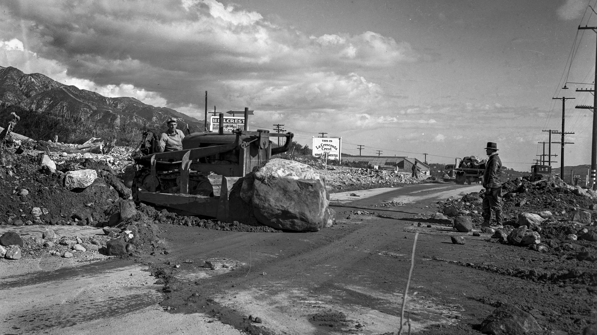 March 4, 1938: Road crew removes debris from Foothill Boulevard at Lowell Street near Tujunga. This