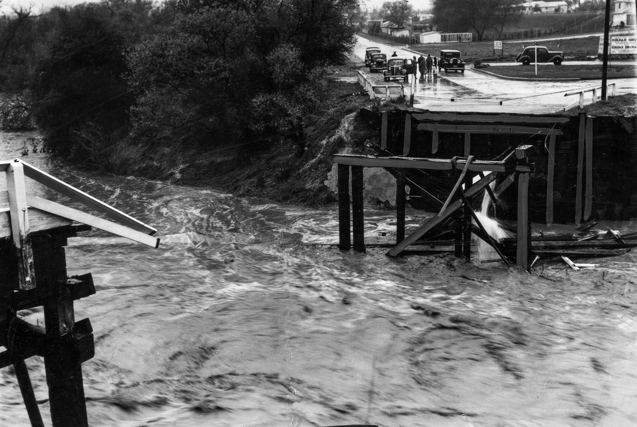 March 2, 1938: Washed out bridge at Colfax Avenue over Los Angeles River in Studio City. This photo