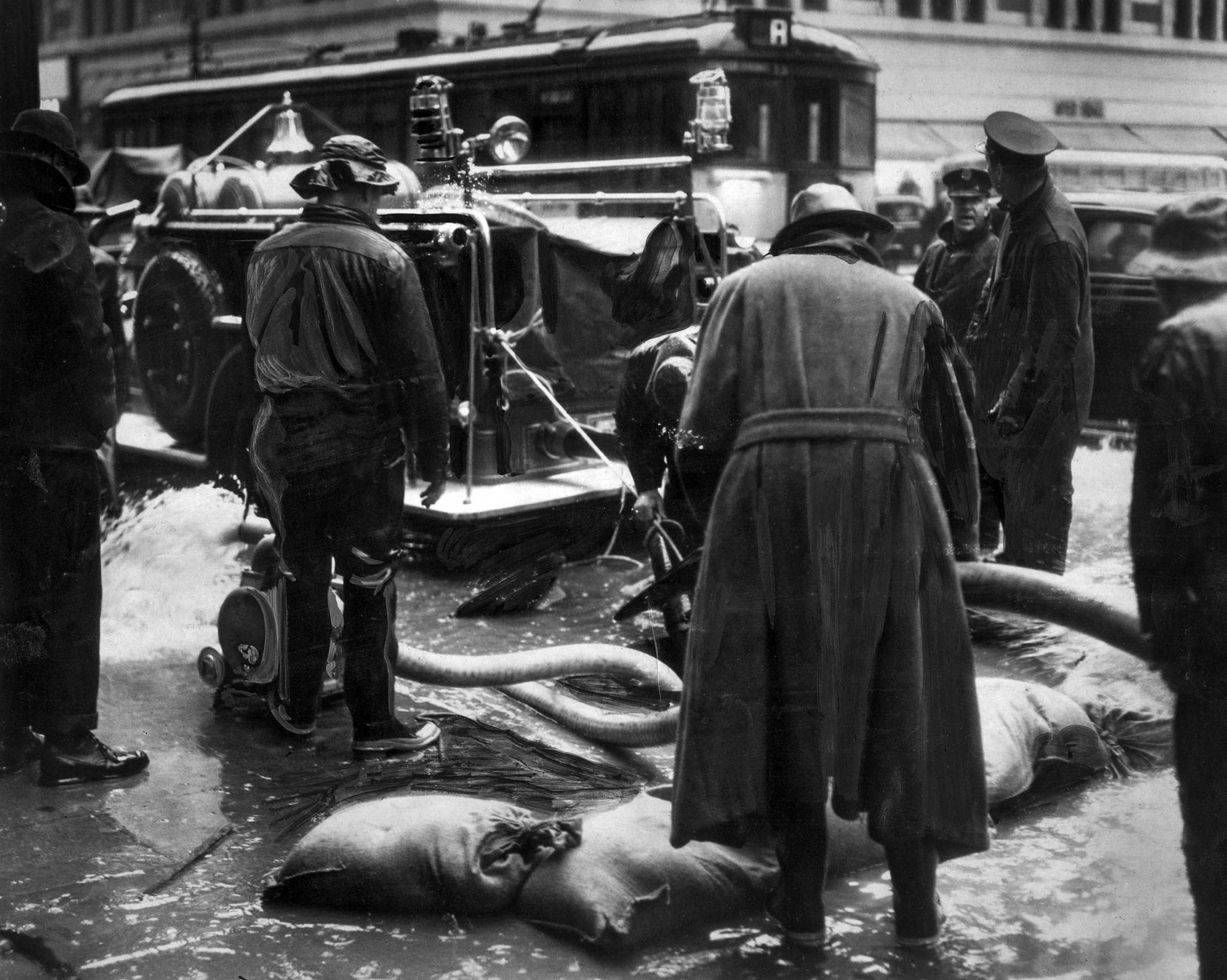 March 2, 1938: Water rising about the drain level in underground conduits threatened telephone servi