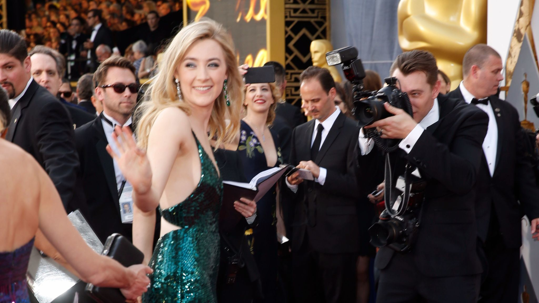 Saoirse Ronan at the Oscars in 2016, wearing a green dress for Ireland.