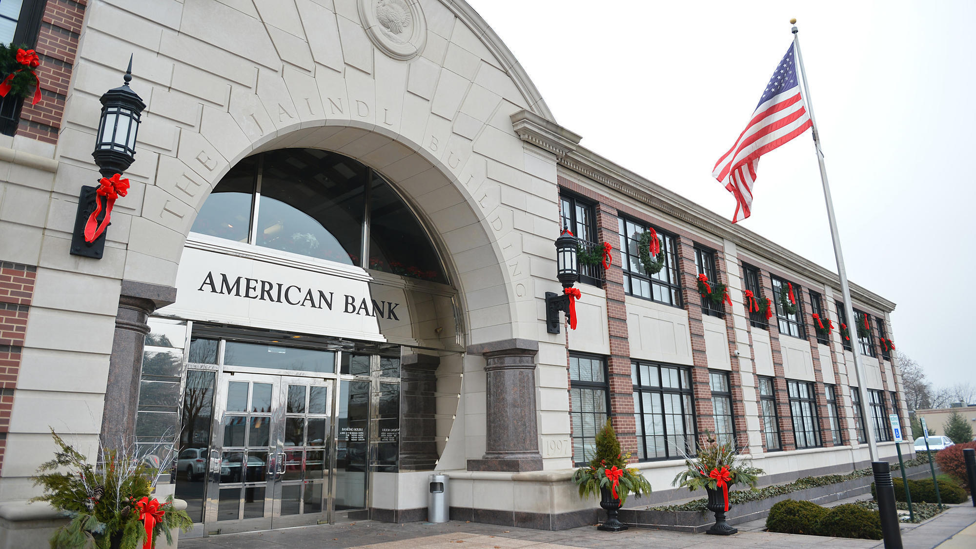 The Bottom Line: Federal Tax Cut Helps American Bank Reach
