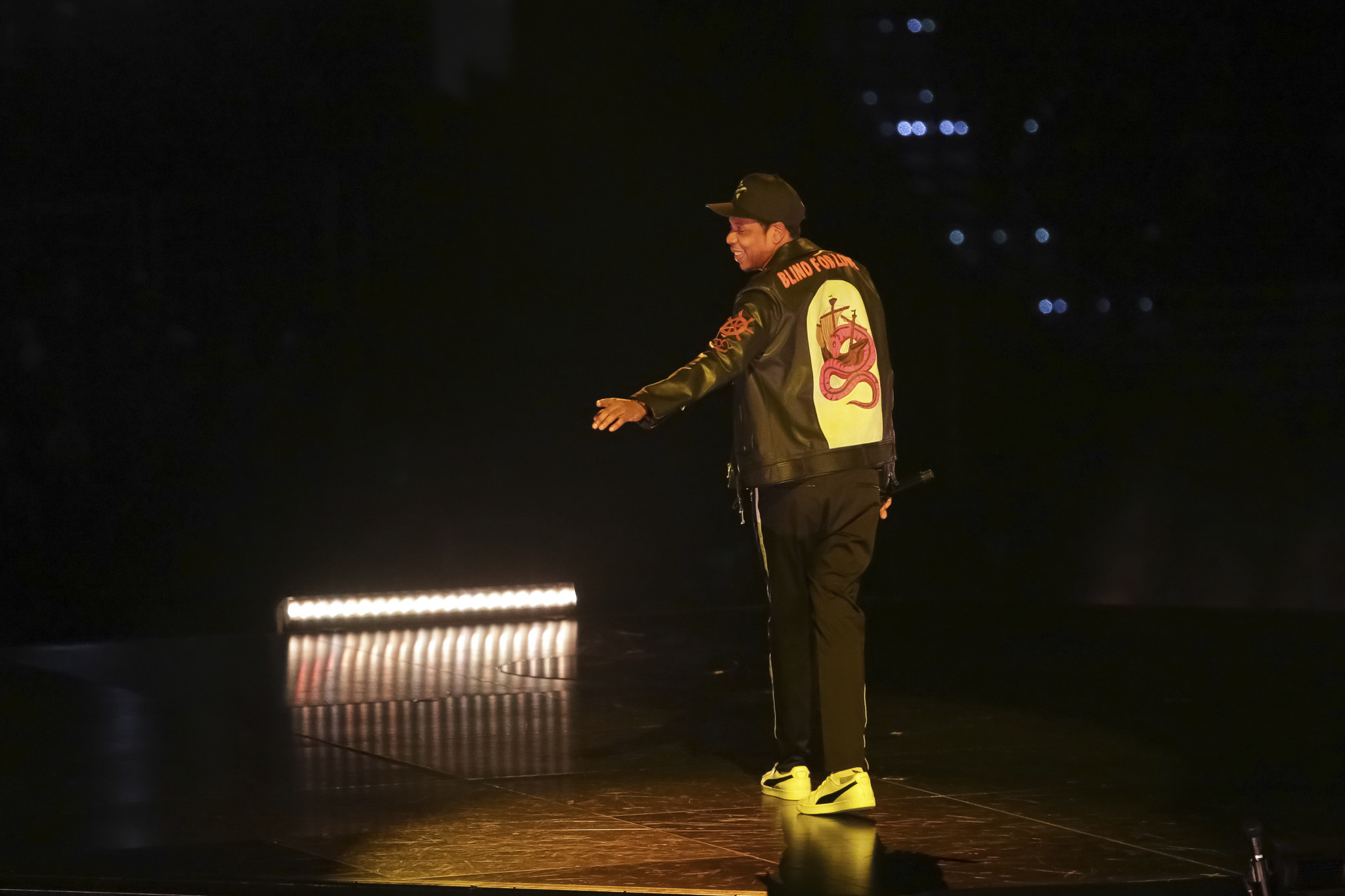 366e94f87 On his 4:44 Tour, Jay-Z, wearing a Gucci jacket, performs onstage at  Capital One Arena on Nov. 29, 2017, in Washington, D.C. Brent N. Clarke /  Invision / AP