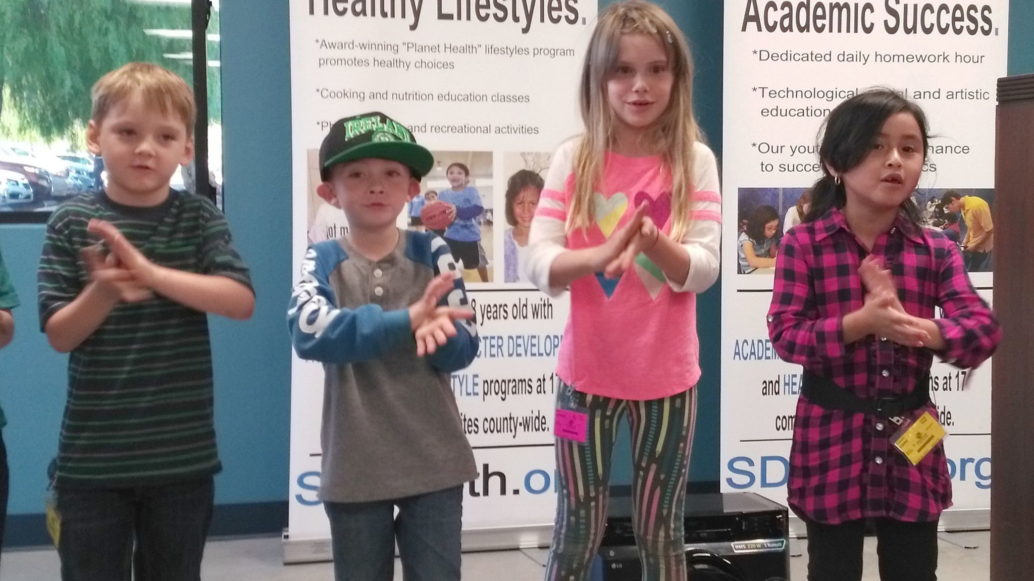 Ramona Boys & Girls Clubs members performing a baby bumble bee song during a ribbon-cutting event, from left, are: Kieran Wingate, Peter Pelayo, Olivia Chandler, Tonantzin Torres.