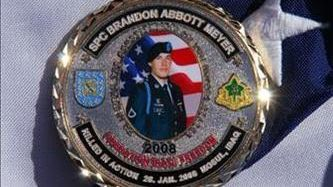 A military-style coin with Brandon Meyer's photo recognizes his service and his ultimate sacrifice on the battlefield where he died in Mosul, Iraq, on Jan. 28, 2008.