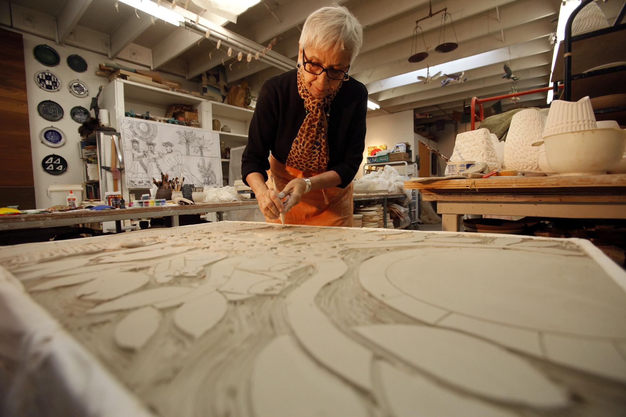 "LOS ANGELES, CA - DECEMBER 22, 2014 — Ceramic artist Dora De Larios carves her latest piece, ""The T"