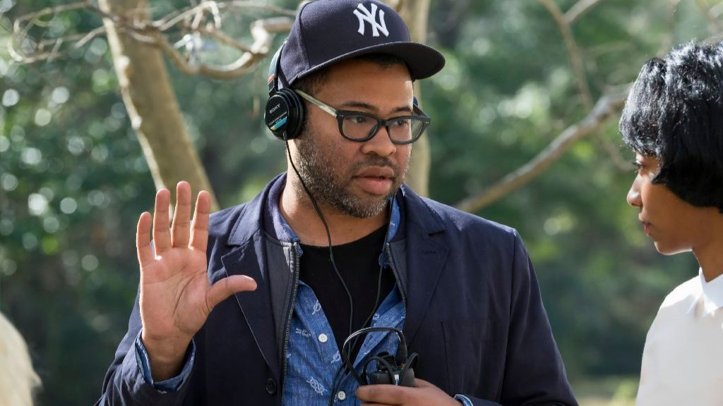 Jordan Peele with actress Betty Gabriel as the maid/grandmother on the set of