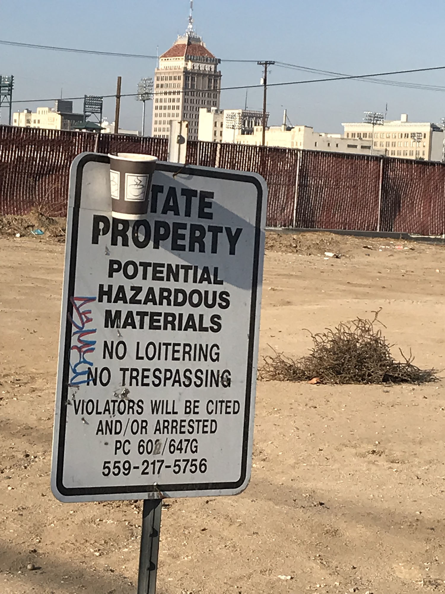 A sign at G and Tulare streets in Fresno marks state property.