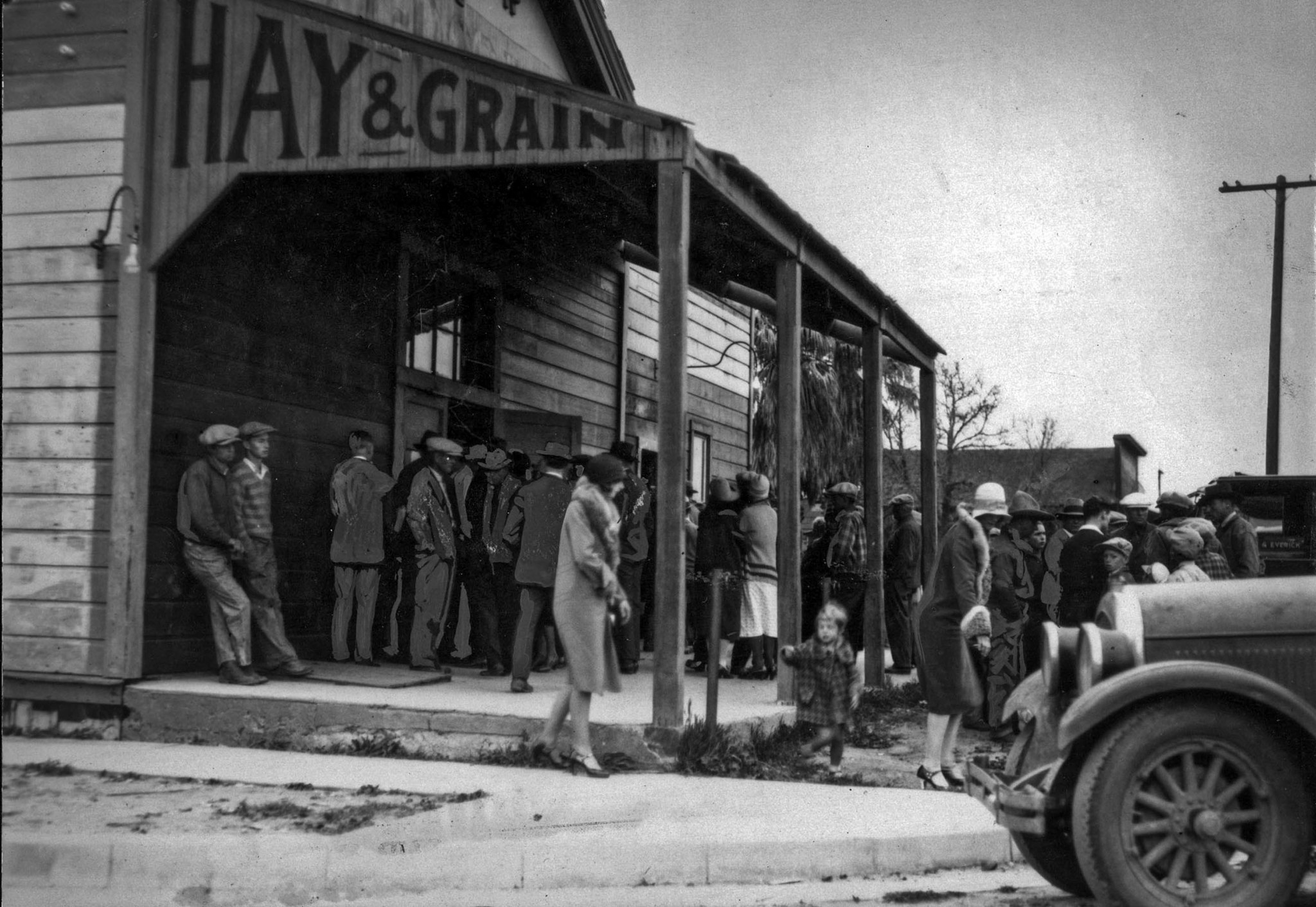 March 14. 1928: Crowd gathers outside temporary morgue seeking to identify victims. The first search