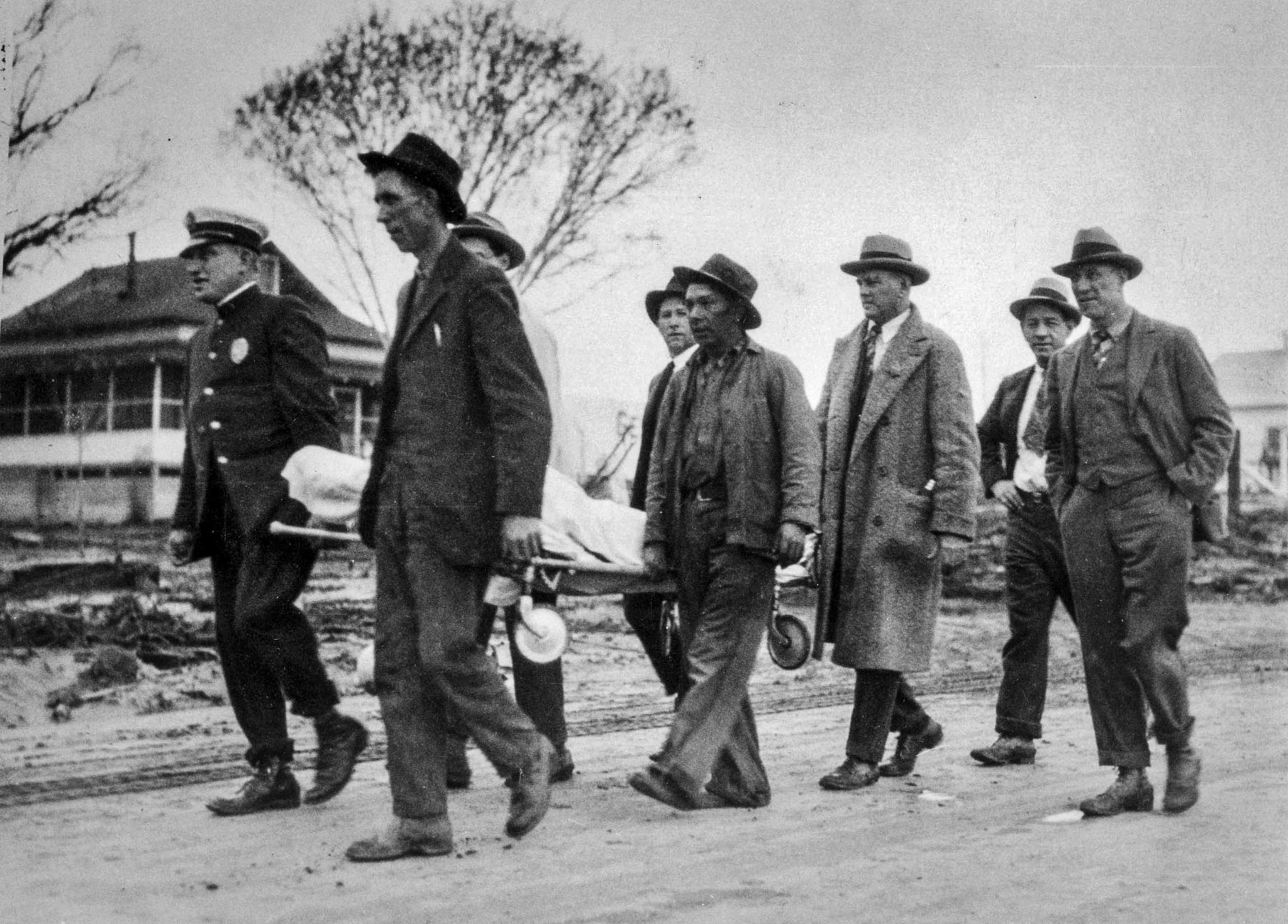 March 13, 1928: Relief workers carrying remains of victim of St. Francis Dam collapse. This photo wa