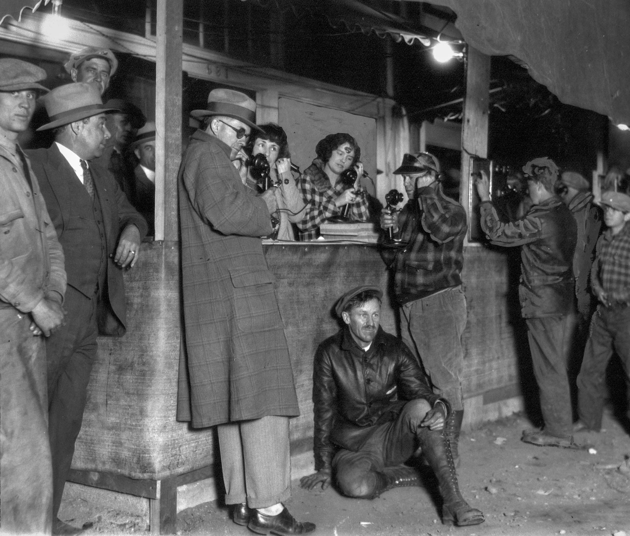 March 1928: Phones in use at emergency telephone station seeking news of flood after collapse of St