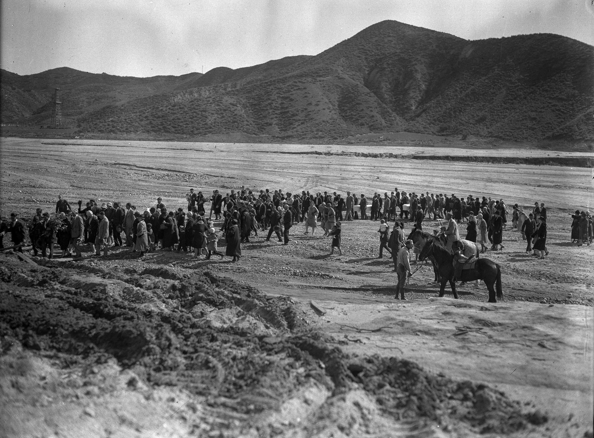March 1928: Funeral procession proceeds across flood plain following the St. Francis Dam disaster.
