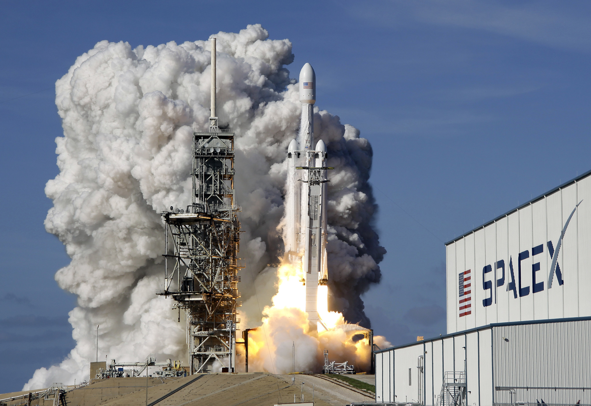 SpaceX's big new rocket blasts off, puts sports car in ...