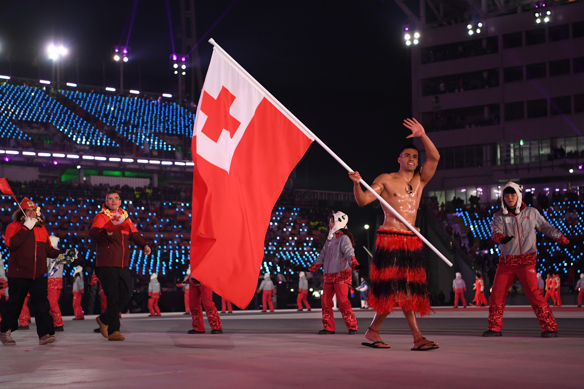 Shirtless Tongan flagbearer grabs Olympic attention again