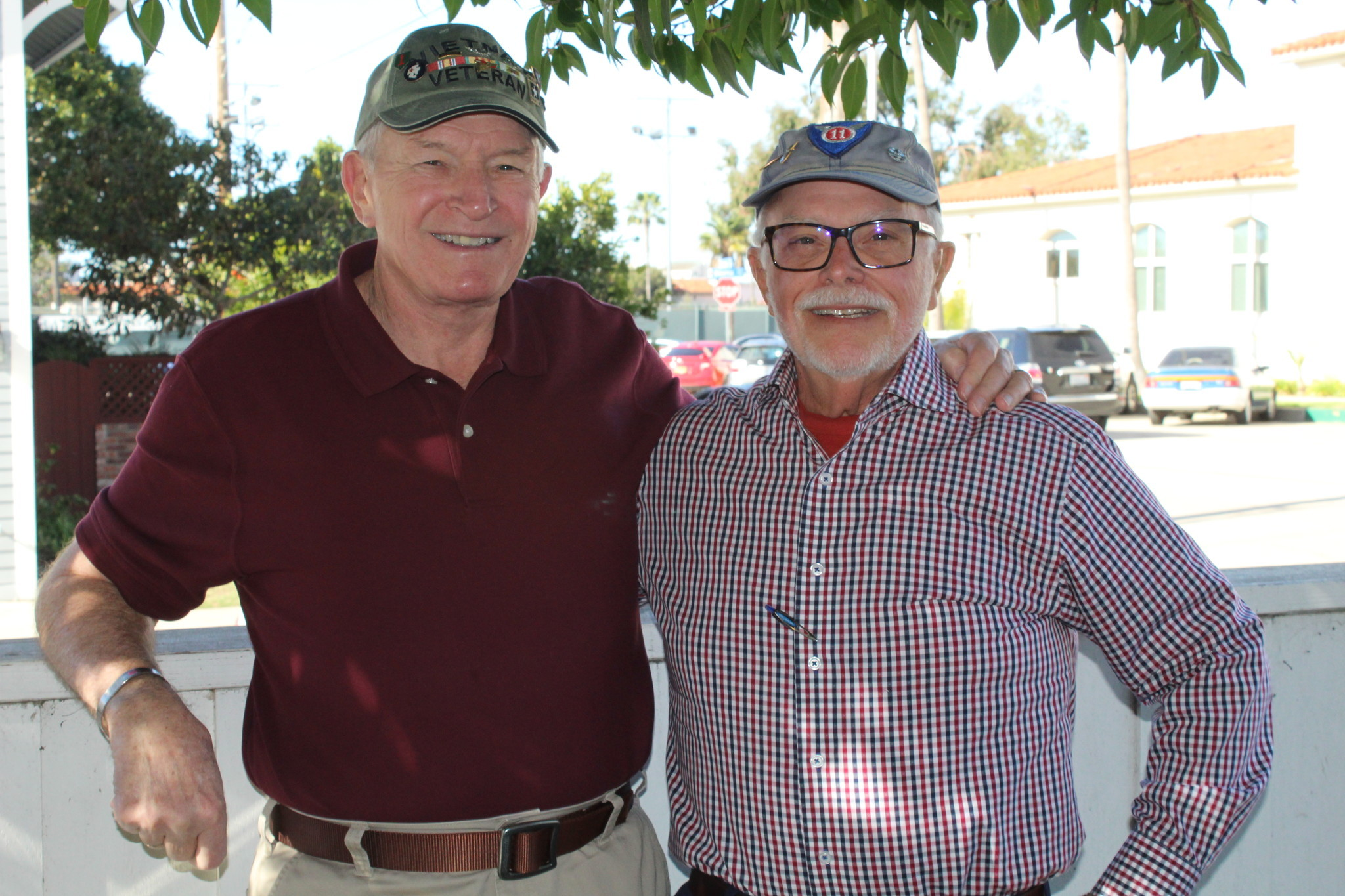 Ray Bender, left, poses in his backyard with his fellow U.S. Army veteran Fred Thacher.